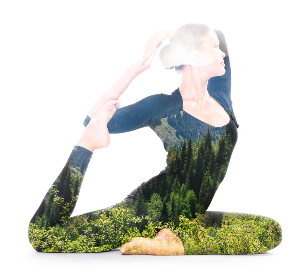 Double exposure portrait of woman performing yoga asana reflects unity of human and nature